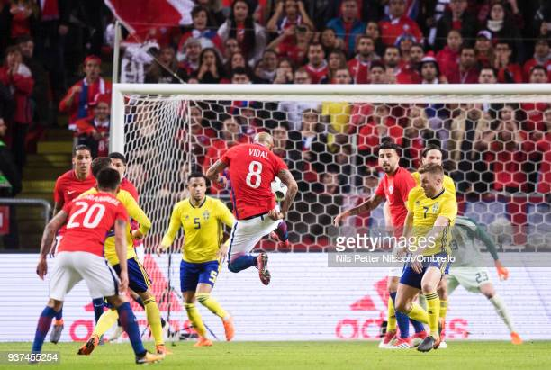 Arturo Vidal of Chile scores the opening goal to 01 during the International Friendly match between Sweden and Chile at Friends arena on March 24...