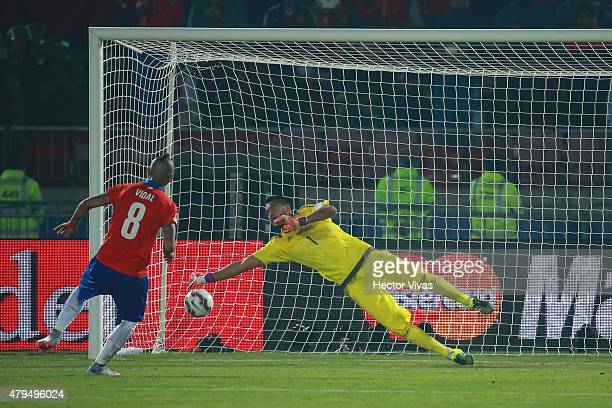 Arturo Vidal of Chile scores the second penalty kick in the penalty shootout during the 2015 Copa America Chile Final match between Chile and...