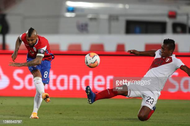 Arturo Vidal of Chile shoots to score the first goal of his team during a match between Chile and Peru as part of South American Qualifiers for Qatar...
