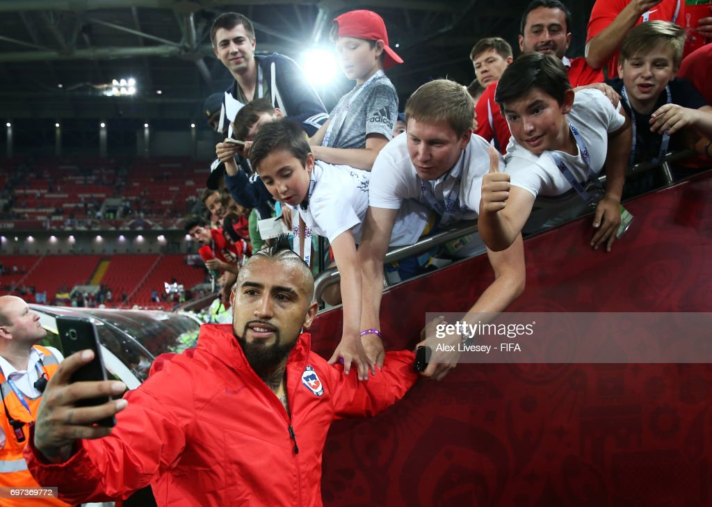 Arturo Vidal of Chile takes a selfie photograph with Chile fans after the FIFA Confederations Cup Russia 2017 Group B match between Cameroon and Chile at Spartak Stadium on June 18, 2017 in Moscow, Russia.