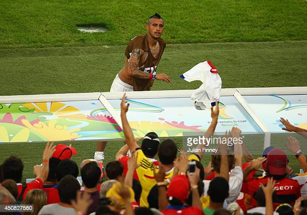 Arturo Vidal of Chile throws his jersey into the crowd after defeating Spain 20 during the 2014 FIFA World Cup Brazil Group B match between Spain and...