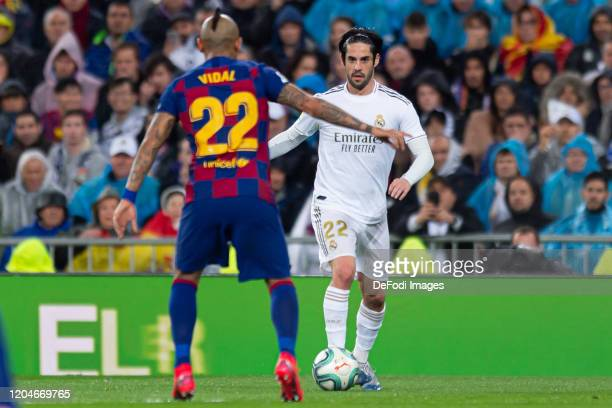 Arturo Vidal of FC Barcelona and Isco Alarcon of Real Madrid battle for the ball during the Liga match between Real Madrid CF and FC Barcelona at...
