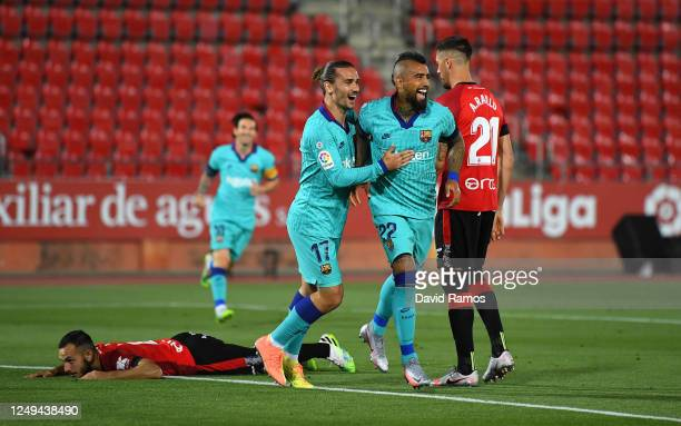 Arturo Vidal of FC Barcelona celebrates after scoring his team's first goal with Antoine Griezmann of FC Barcelona during the La Liga match between...