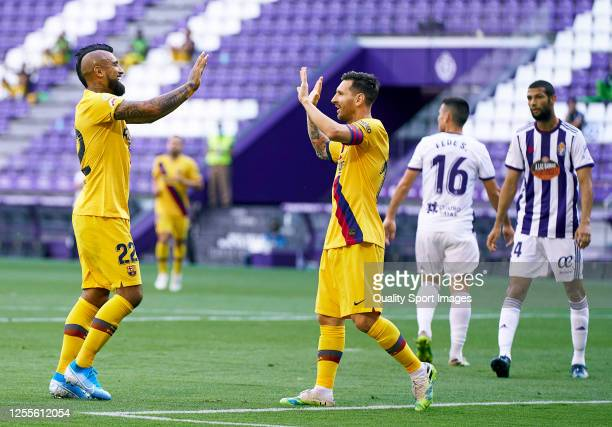 Arturo Vidal of FC Barcelona celebrates after scoring his team's first goal with his teammate Lionel Messi during the Liga match between Real...
