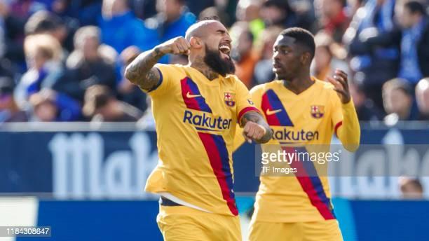 Arturo Vidal of FC Barcelona celebrates his goal with team mates during the Liga match between CD Leganes and FC Barcelona at Estadio Municipal de...