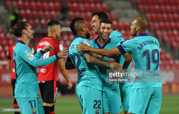 Arturo Vidal of FC Barcelona celebrates with Sergi Roberto and teammates after scoring his sides first goal during the La Liga match between RCD...