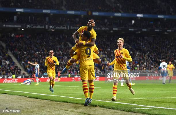 Arturo Vidal of FC Barcelona celebrates with teammates after scoring his team's second goal during the La Liga match between RCD Espanyol and FC...