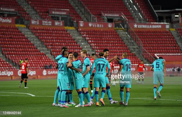Arturo Vidal of FC Barcelona celebrates with teammates after scoring his sides first goal during the La Liga match between RCD Mallorca and FC...