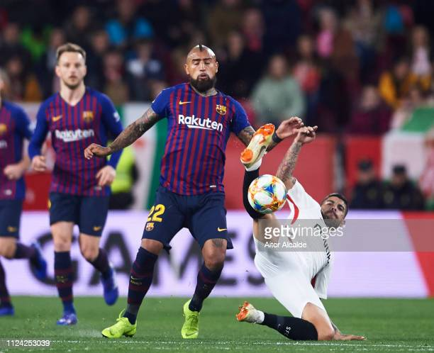 Arturo Vidal of FC Barcelona competes for the ball with Ever Banega of Sevilla FC during the Copa del Quarter Final match between Sevilla FC and FC...