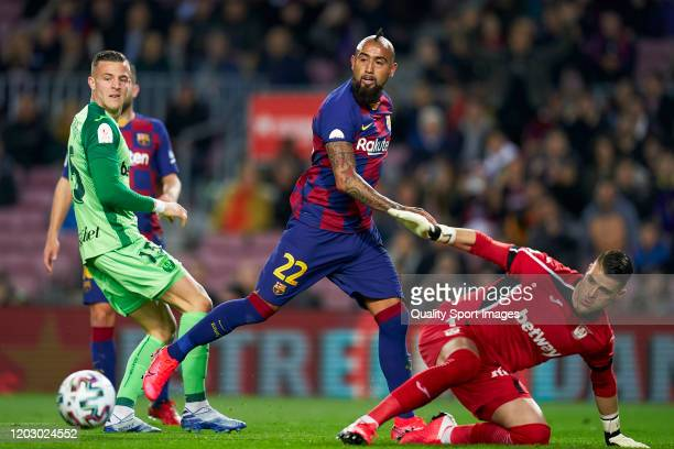 Arturo Vidal of FC Barcelona competes for the ball with Ivan Cuellar of CD Leganes during the Copa del Rey Round of 16 match between FC Barcelona and...