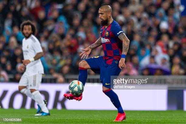 Arturo Vidal of FC Barcelona controls the ball during the Liga match between Real Madrid CF and FC Barcelona at Estadio Santiago Bernabeu on March 1...