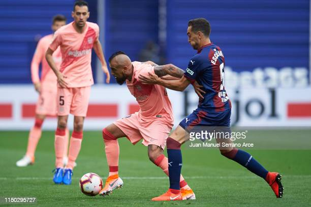 Arturo Vidal of FC Barcelona duels for the ball with Gonzalo Escalante of SD Eibar during the La Liga match between SD Eibar and FC Barcelona at...