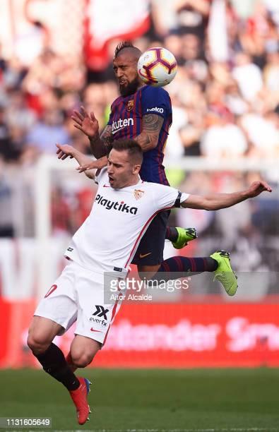 Arturo Vidal of FC Barcelona duels for the ball with Marko Rog of Sevilla FC during the La Liga match between Sevilla FC and FC Barcelona at Estadio...