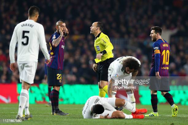 Arturo Vidal of FC Barcelona is shown a yellow card by the referee Mateu Lahoz during the Copa del Semi Final first leg match between Barcelona and...
