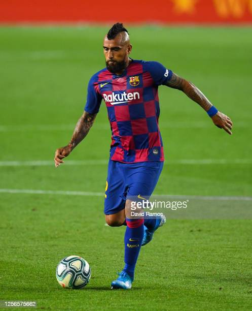 Arturo Vidal of FC Barcelona runs with the ball during the Liga match between FC Barcelona and CA Osasuna at Camp Nou on July 16, 2020 in Barcelona,...