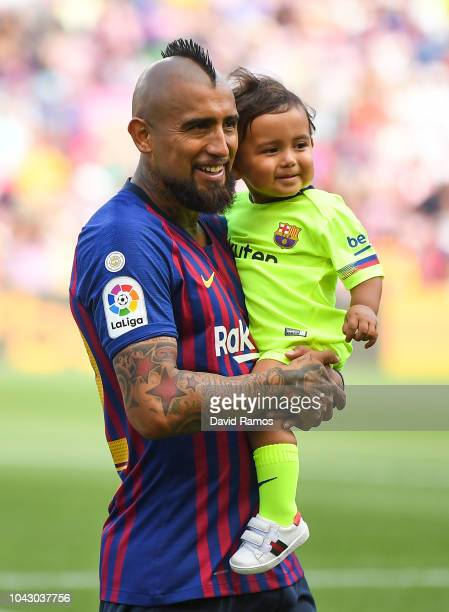 Arturo Vidal of FC Barcelona with his son Emiliano are seen prior to the La Liga match between FC Barcelona and Athletic Club at Camp Nou on...