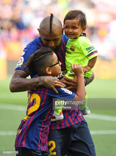 Arturo Vidal of FC Barcelona with his sons Alonso and Emiliano are seen prior to the La Liga match between FC Barcelona and Athletic Club at Camp Nou...