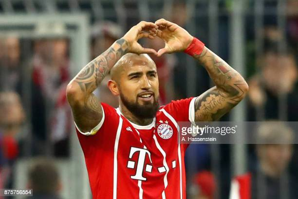 Arturo Vidal of FC Bayern Muenchen celebrates scoring the opening goal during the Bundesliga match between FC Bayern Muenchen and FC Augsburg at...