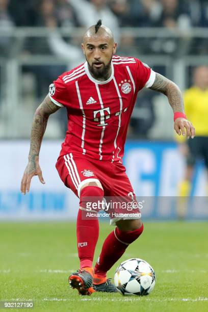 Arturo Vidal of FC Bayern Muenchen runs with the ball during the UEFA Champions League Round of 16 Second Leg match Besiktas and Bayern Muenchen at...