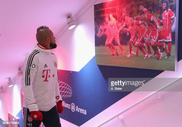 Arturo Vidal of FC Bayern Muenchen watches a photograph at the players' tunnel before the Bundesliga match between FC Bayern Muenchen and Werder...