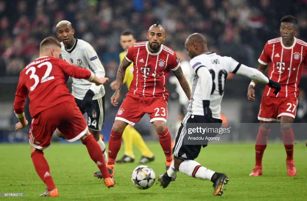 Arturo Vidal (23) of FC Bayern Munich in action against Vagner Love (2nd R) of Besiktas during the UEFA Champions League Round of 16 soccer match between FC Bayern Munich and Besiktas at the Allianz Arena in Munich, Germany, on February 20, 2018.