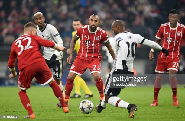 Arturo Vidal of FC Bayern Munich in action against Vagner Love of Besiktas during the UEFA Champions League Round of 16 soccer match between FC...