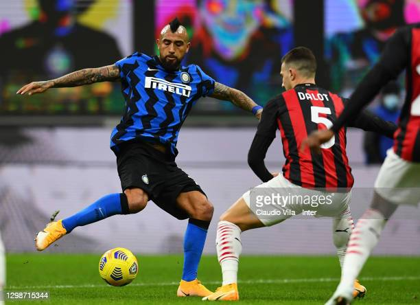 Arturo Vidal of FC Internazionale competes for the ball with Diogo Dalot of AC Milan during the Coppa Italia match between FC Internazionale and AC...