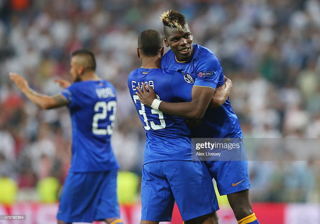 Arturo Vidal of Juventus and Paul Pogba of Juventus celerate following their team's progression to the final during the UEFA Champions League Semi Final, second leg match between Real Madrid and Juventus at Estadio Santiago Bernabeu on May 13, 2015 in Madrid, Spain.