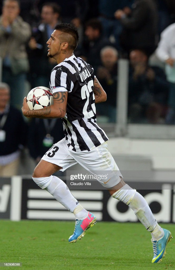 Arturo Vidal of Juventus celebrates after scoring his team's first goal from a penalty to equalise during the UEFA Champions League Group B match between Juventus and Galatasaray AS at Juventus Arena on October 2, 2013 in Turin, Italy.