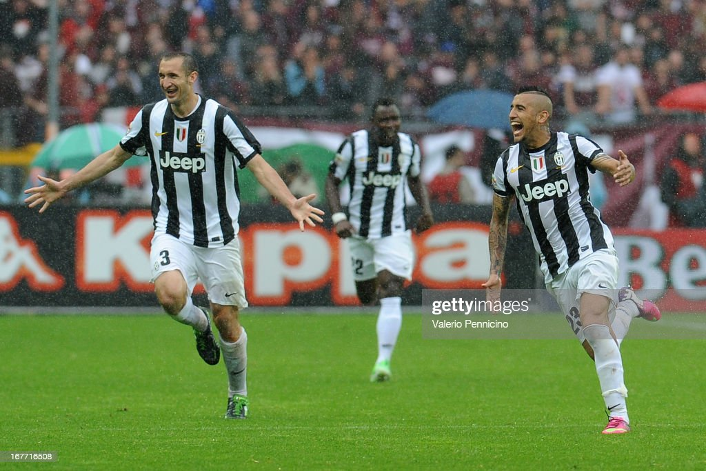 Arturo Vidal (R) of Juventus celebrates after scoring the opening goal during the Serie A match between Torino FC and Juventus at Stadio Olimpico di Torino on April 28, 2013 in Turin, Italy.