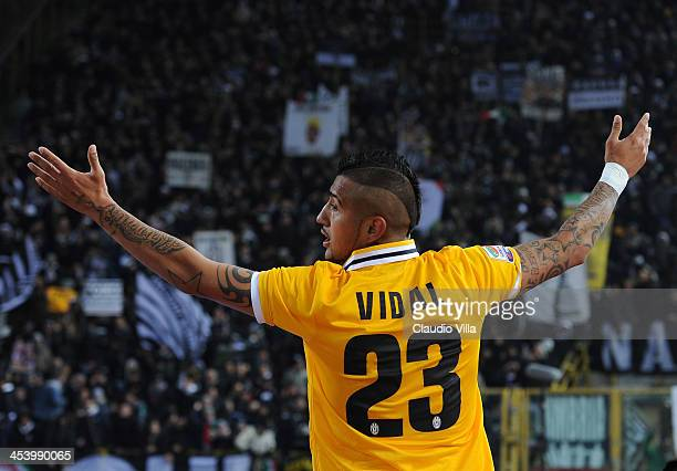 Arturo Vidal of Juventus celebrates scoring the first goal during the Serie A match between Bologna FC and Juventus at Stadio Renato Dall'Ara on...