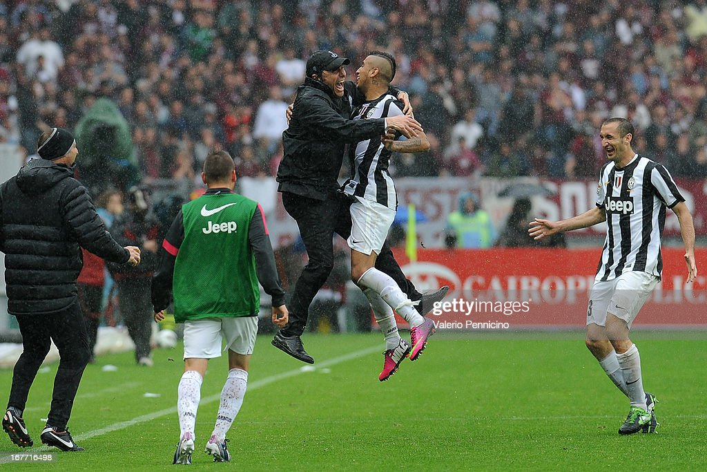 Arturo Vidal (R) of Juventus celebrates with his head coach Antonio Conte after scoring the opening goal during the Serie A match between Torino FC and Juventus at Stadio Olimpico di Torino on April 28, 2013 in Turin, Italy.