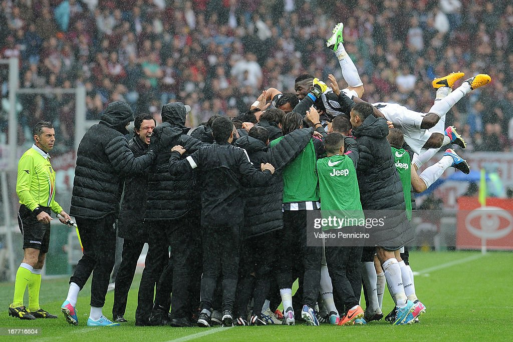 Arturo Vidal (C) of Juventus celebrates with his team mates after scoring the opening goal during the Serie A match between Torino FC and Juventus at Stadio Olimpico di Torino on April 28, 2013 in Turin, Italy.