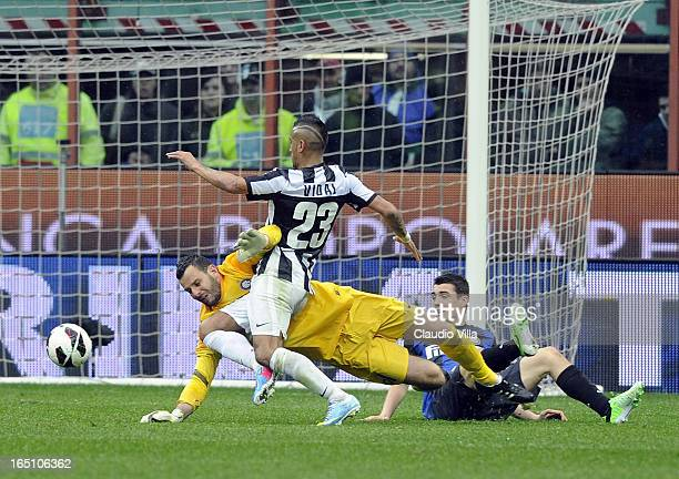Arturo Vidal of Juventus FC and Samir Handanovic of FC Inter Milan compete for the ball during the Serie A match between FC Internazionale Milano and...