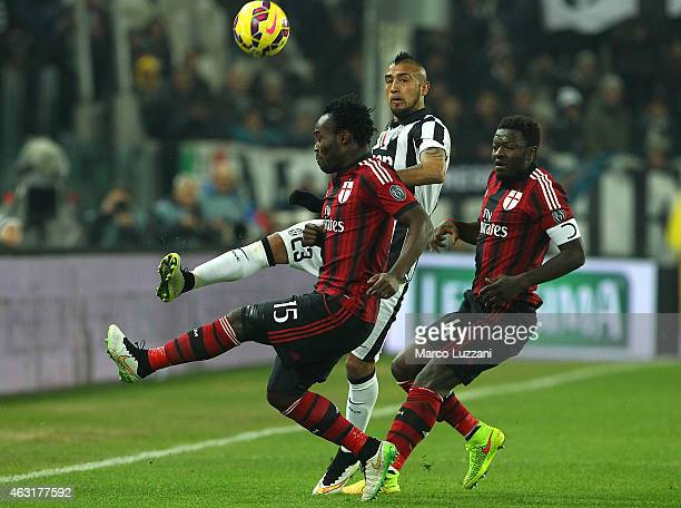 Arturo Vidal of Juventus FC is challenged by Michael Essien and Sulley Ali Muntari of AC Milan during the Serie A match between Juventus FC and AC...