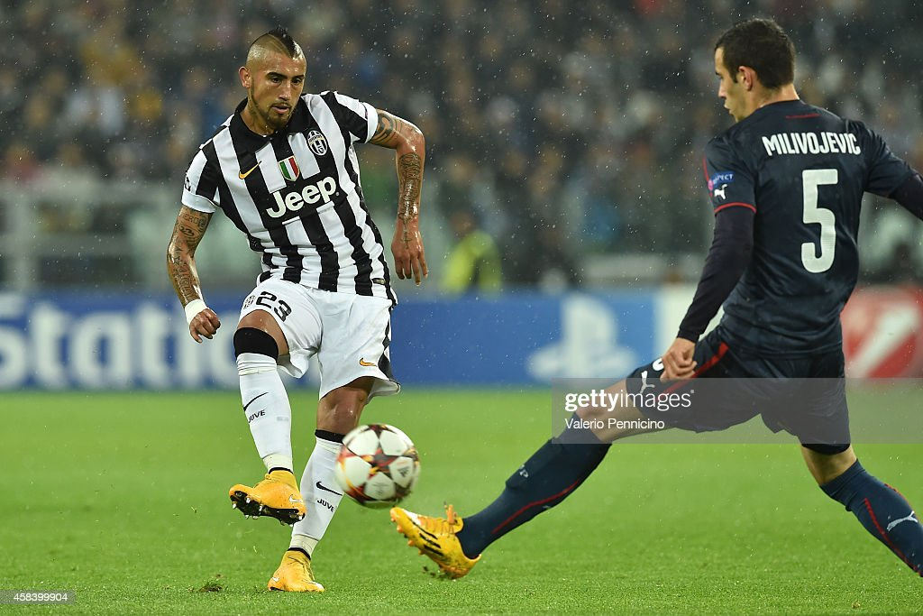 Arturo Vidal (L) of Juventus in action against Luka Milivojevic of Olympiacos FC during the UEFA Champions League group A match between Juventus and Olympiacos FC at Juventus Arena on November 4, 2014 in Turin, Italy.