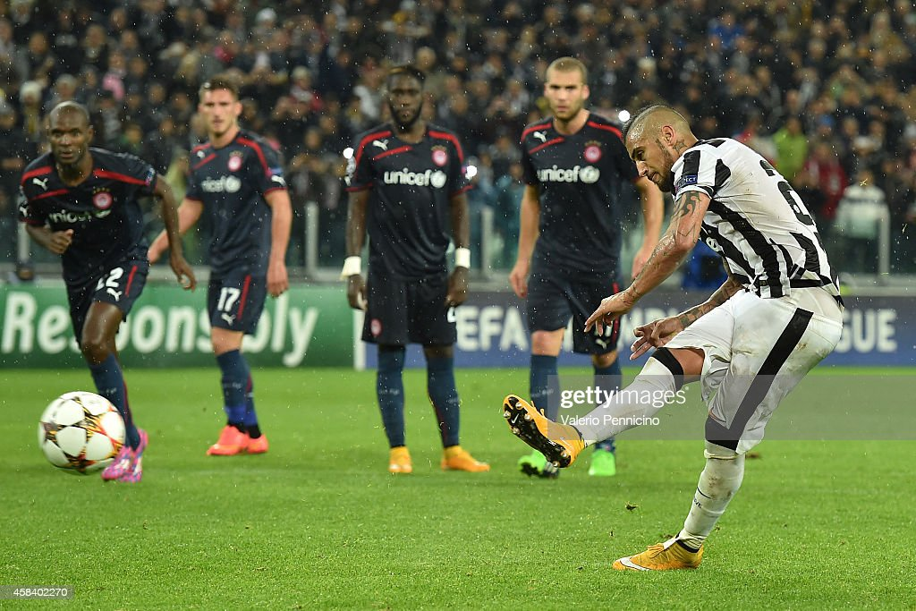 Arturo Vidal (R) of Juventus misses a penalty during the UEFA Champions League group A match between Juventus and Olympiacos FC at Juventus Arena on November 4, 2014 in Turin, Italy.