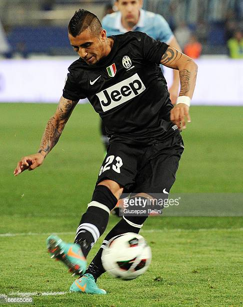 Arturo Vidal of Juventus scores the opening goal from the penalty spot during the Serie A match between S.S. Lazio and Juventus at Stadio Olimpico on...