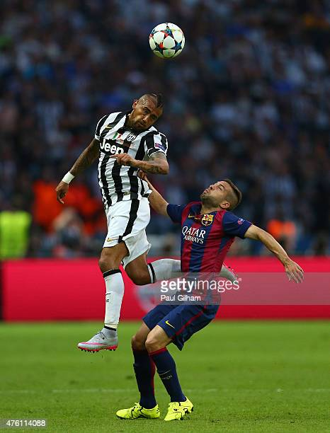 Arturo Vidal of Juventus wins a header with Jordi Alba of Barcelona during the UEFA Champions League Final between Juventus and FC Barcelona at...
