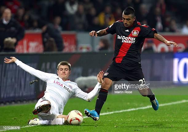 Arturo Vidal of Leverkusen and Toni Kroos of Bayern Meunchen battle for the ball during the Bundesliga match between Bayer Leverkusen and Bayern...