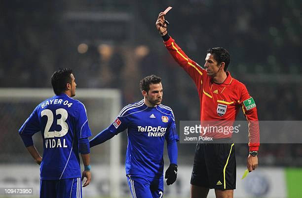 Arturo Vidal of Leverkusen gets the red card from referee Deniz Aytekin during the Bundesliga match between Werder Bremen and Bayer Leverkusen at...