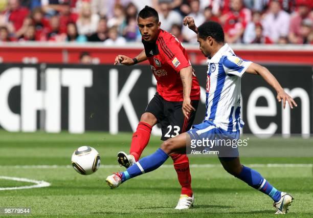 Arturo Vidal of Leverkusen is challenged by Raffael of Berlin during the Bundesliga match between Bayer Leverkusen and Hertha BSC Berlin at the...