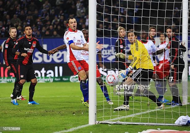Arturo Vidal of Leverkusen scores an own goal during the Bundesliga match between Hamburger SV and Bayer Leverkusen at Imtech Arena on December 11,...