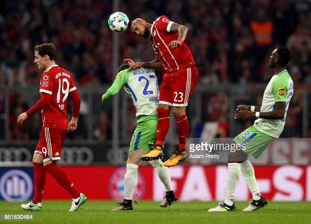 Arturo Vidal of Muenchen and Joshua Guilavogui of Wolfsburg battle for the ball during the Bundesliga match between FC Bayern Muenchen and VfL...