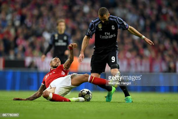 Arturo Vidal of Muenchen and Karim Benzema of Real Madrid battle for the ball during the UEFA Champions League Quarter Final first leg match between...