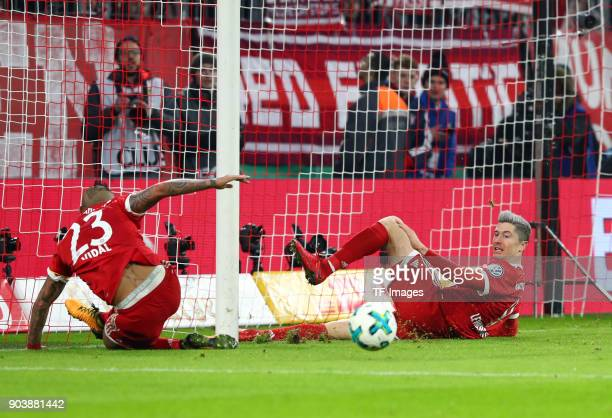 Arturo Vidal of Muenchen and Robert Lewandowski of Muenchen on the ground during the DFB Cup match between Bayern Muenchen and Borussia Dortmund at...