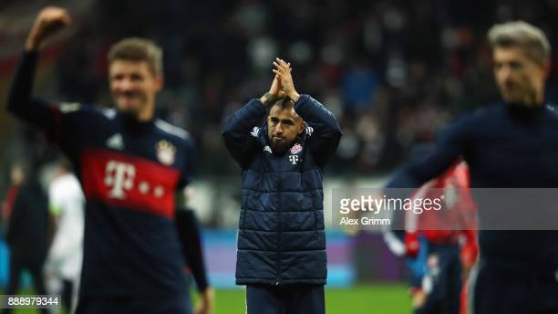 Arturo Vidal of Muenchen and team mates celebrate with the fans after the Bundesliga match between Eintracht Frankfurt and FC Bayern Muenchen at...