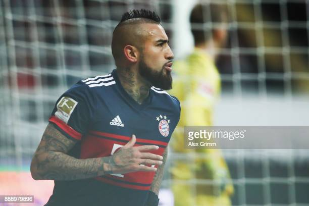 Arturo Vidal of Muenchen celebrates his team's first goal during the Bundesliga match between Eintracht Frankfurt and FC Bayern Muenchen at...