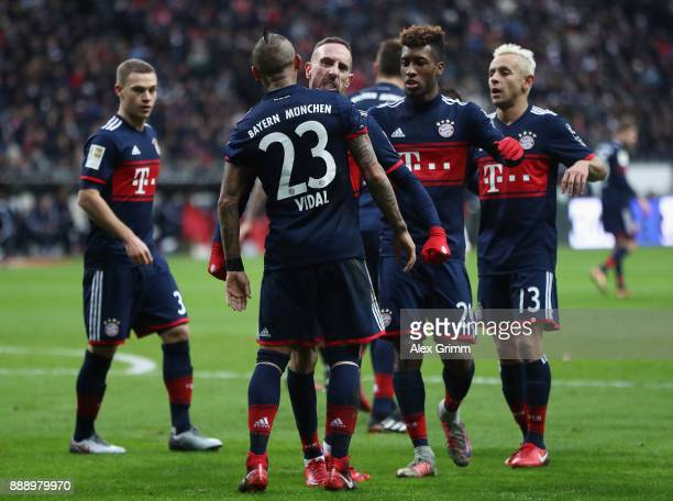 Arturo Vidal of Muenchen celebrates his team's first goal with team mates during the Bundesliga match between Eintracht Frankfurt and FC Bayern...