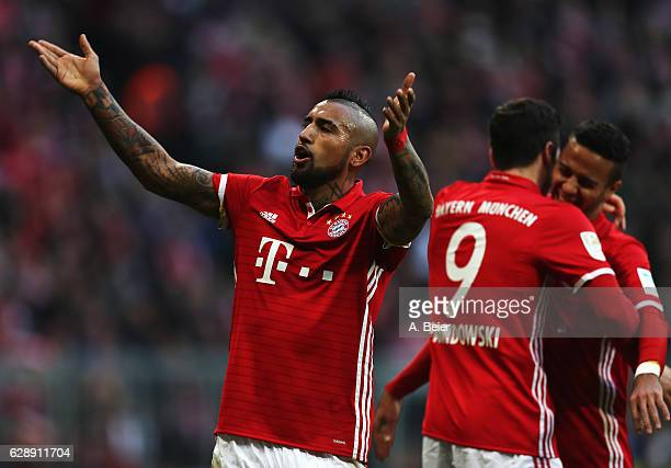 Arturo Vidal of Muenchen celebrates the second goal scored by Robert Lewandowski during the Bundesliga match between Bayern Muenchen and VfL...